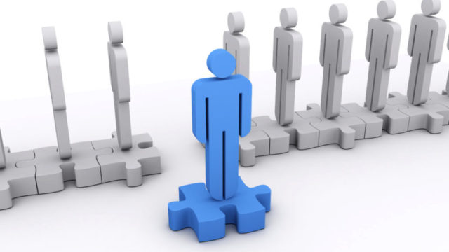 A blue character stepped out of the line. Concept of standing out, leadership, teamwork,